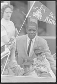 Baseball player Minnie Minoso of the Washington Senators and some young fans attend a fundraising function for Children's Hospital in Washington DC