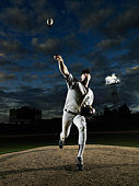 Baseball player pitching off mound