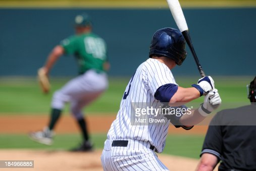 A baseball player preparing to swing his bat