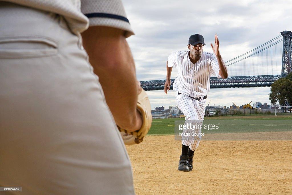 Baseball player running : Stock Photo