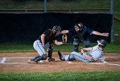 Baseball Player Slides Into Home Plate