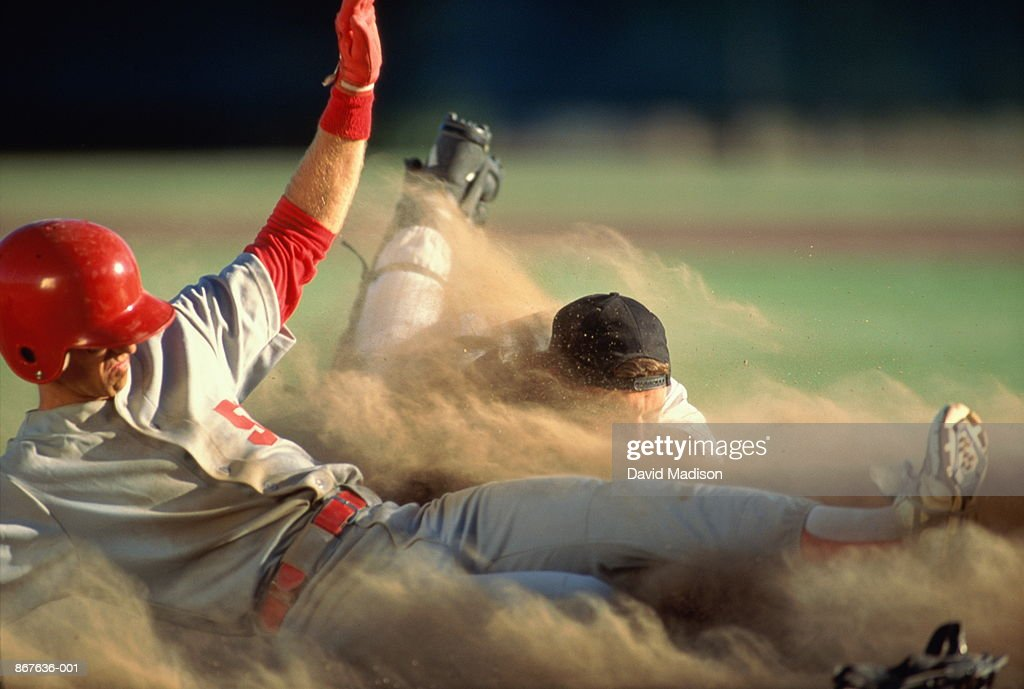 Baseball, player sliding into home plate, catcher trying to tag : Stock-Foto