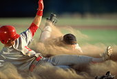 Baseball, player sliding into home plate, catcher trying to tag