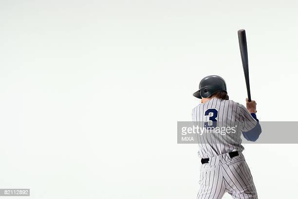 Baseball player standing with bat