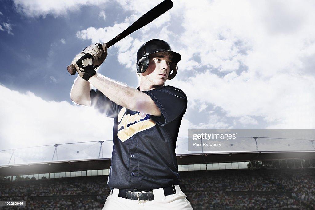 Baseball player swinging baseball bat : Stock Photo