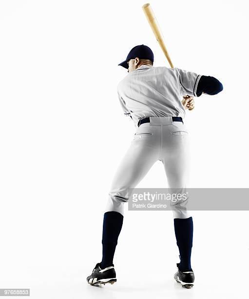 Baseball Player Swinging bat from behind
