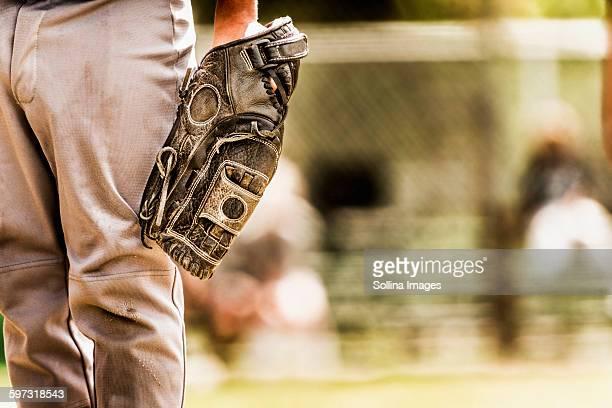 Baseball player wearing baseball glove