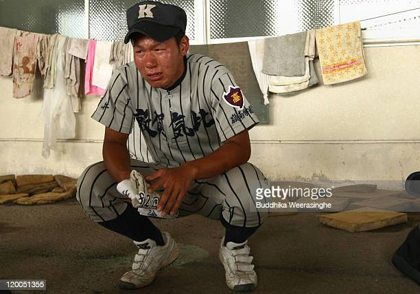 A baseball player weeps after their team didn't qualify in the national tournament during the High School Baseball Tournament Fukui Prefecture semi...