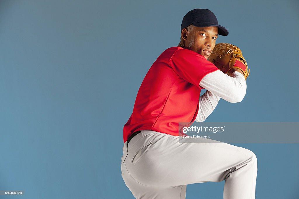 Baseball player winding up a pitch : Stock Photo