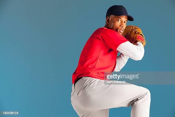 Baseball player winding up a pitch
