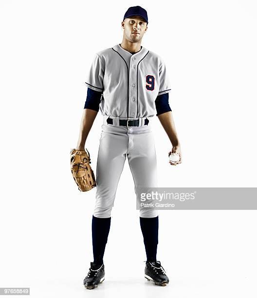 Baseball Player with glove and baseball