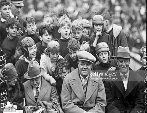 Baseball players Babe Ruth and Lou Gehrig of the New York Yankees surrounded by a group of boy football players and adults Chicago Illinois 1927 From...