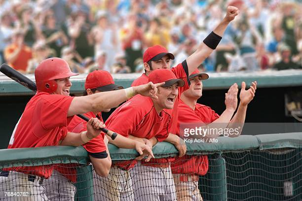 Baseball players cheering