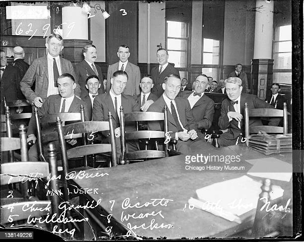 Baseball players Gandil Williams Williams Risberg Cicotte Weaver and Joe Jackson White Sox and attorney Nash sitting in a courtroom Chicago Illinois...