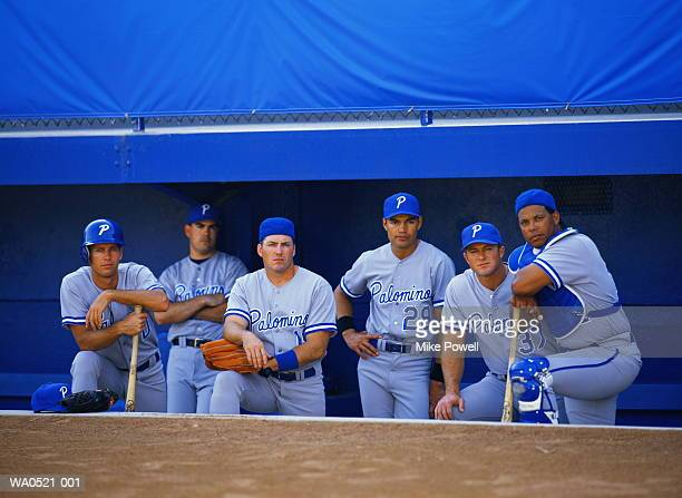 Baseball players in dugout