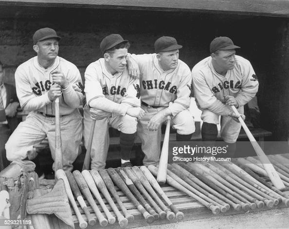 Baseball players Stephenson Hazen Cuyler Rogers Hornsby and Hack Wilson of the National League's Chicago Cubs standing in a dugout probably at a...