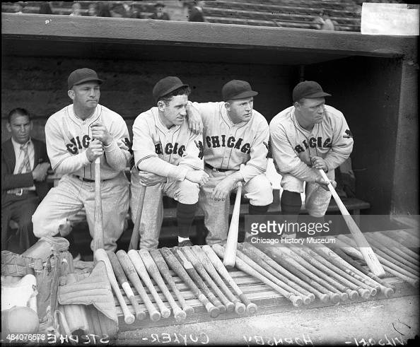 Baseball players Stephenson Hazen 'Kiki' Cuyler Rogers Hornsby and Hack Wilson of the National League's Chicago Cubs standing in a dugout probably at...