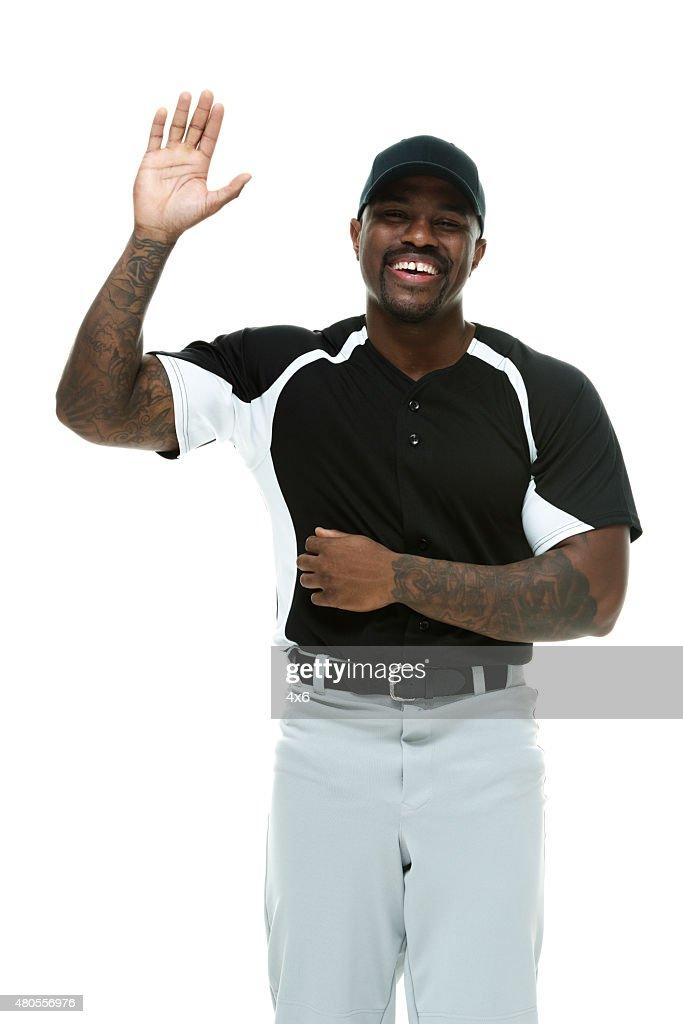 Baseball players waving at camera : Stock Photo