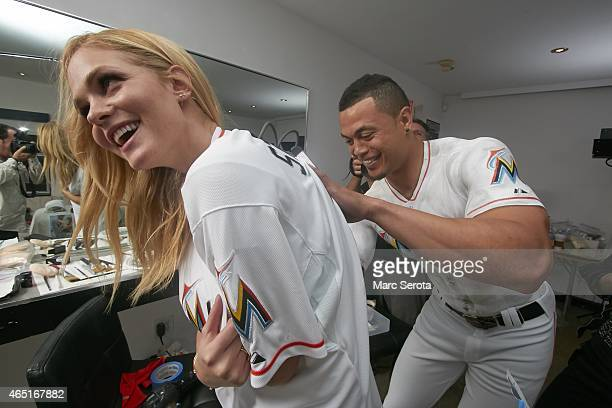 Portrait of Miami Marlins outfielder Giancarlo Stanton with swimsuit model Erin Heatherton after getting bodypaint version of his jersey during photo...