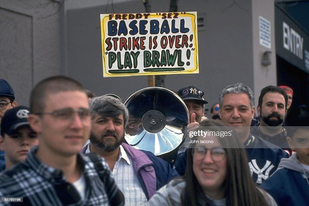 Post MLB Strike View of fan outside Yankee Stadium with FREDDY SEZ BASEBALL STRIKE IS OVER PLAY BAWL sign before New York Yankees vs Texas Rangers...