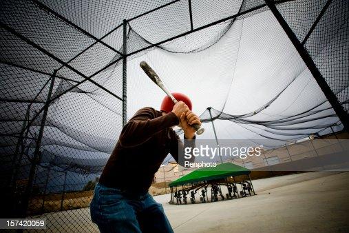 Baseball Practice: Man at Batting Cages