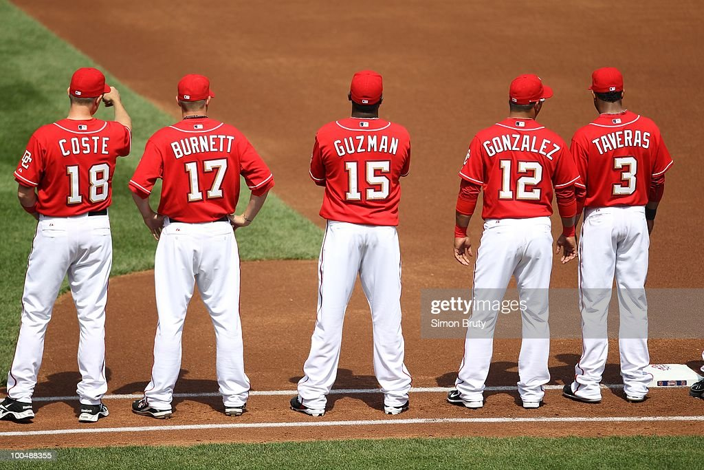 Rear view of Washington Nationals (L-R) Chris Coste (18), Sean Burnett (17), Cristian Guzman (15), Alberto Gonzalez (12), and Willy Taveras (3) before opening day game vs Philadelphia Phillies. Washington, DC 4/5/2010