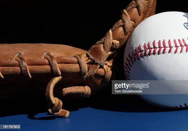 A baseball rests beside the catcher's glove of Chris Snyder of the Baltimore Orioles before the start of MLB game action against the Toronto Blue...