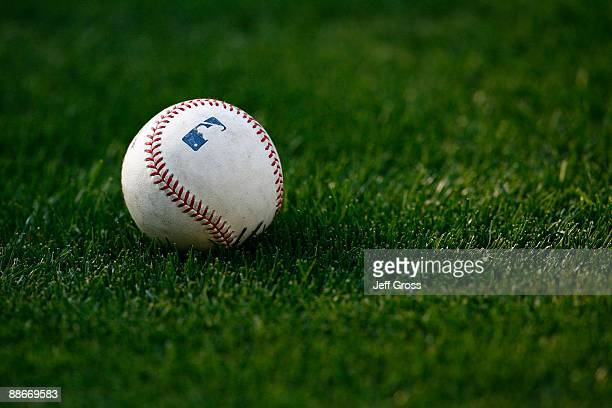 A baseball rests on the grass prior to the game between the Oakland Athletics and the Los Angeles Dodgers at Dodger Stadium on June 16 2009 in Los...