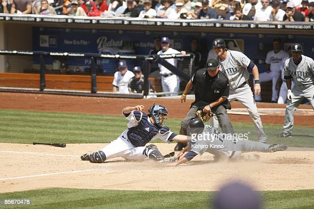 San Diego Padres Josh Bard in action attempting tag during home plate slide by Seattle Mariners Jamie Burke San Diego CA 6/10/2007 CREDIT Kohjiro...