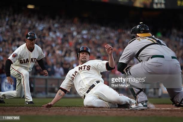 San Francisco Giants Aubrey Huff in action tagged out at home plate vs Oakland Athletics Landon Powell at ATT Park San Francisco CA CREDIT Brad Mangin