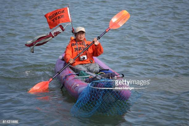 Baseball San Francisco Giants fan on kayak with BONDS NAVY sign in McCovey Cove during game vs Atlanta Braves San Francisco CA 7/26/2007