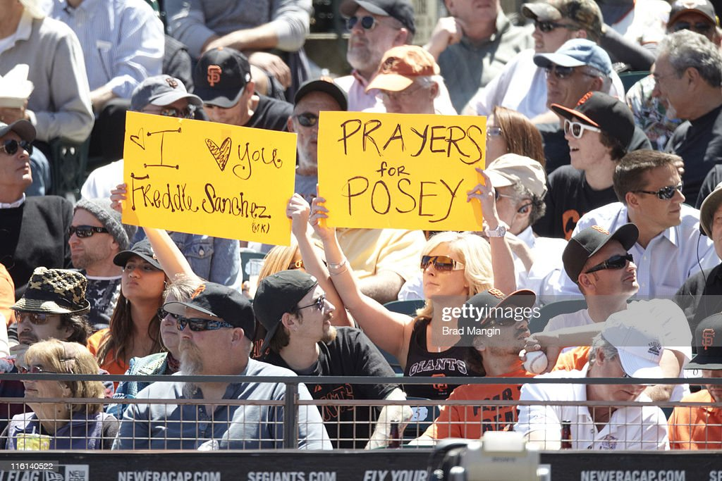 San Francisco Giants fans in crowd during game vs Florida Marlins at AT&T Park. Buster Posey and Freddy Sanchez fans. Brad Mangin F419 )