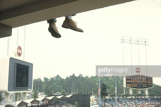 Baseball Scenic view of fans feet and Dodger Stadium scoreboard during Atlanta Braves vs Los Angeles Dodgers game Los Angeles CA 4/28/1995