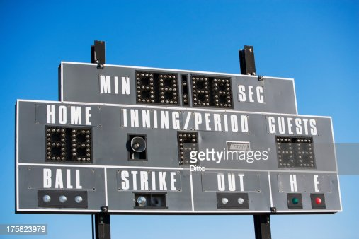 Baseball scoreboard against blue sky