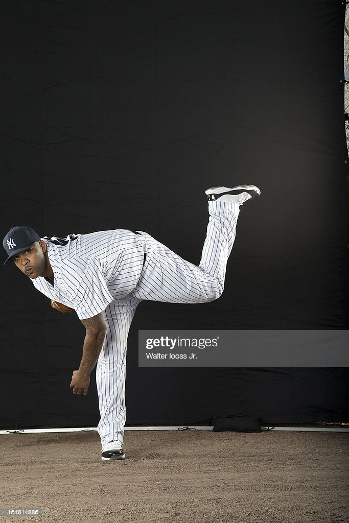 Portrait of New York Yankees pitcher CC Sabathia (52) posing during spring training photo shoot at George M Steinbrenner Field. Cover. Walter Iooss Jr. F98 )