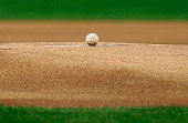 A baseball sits on top of the pitchers mound before the start of a MLB game between the Arizona Diamondbacks and the Pittsburgh Pirates at Chase...