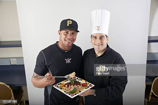 Sports Nutrition Portrait of Pittsburgh Pirates outfielder Jose Tabata with chef Anthony Palatucci during photo shoot at PNC Park Pittsburgh PA...