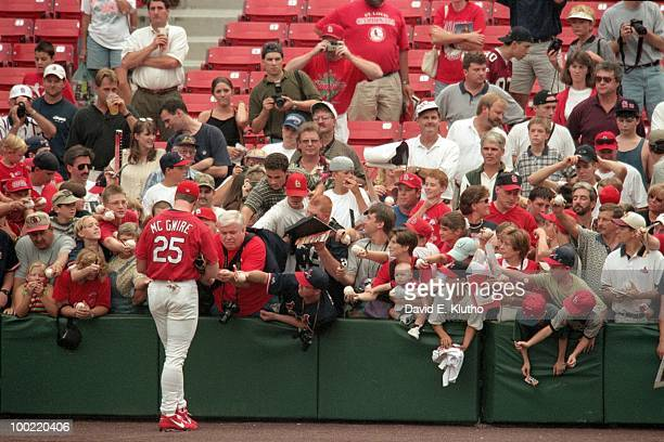 St Louis Cardinals Mark McGwire signing autographs with fans before game vs Atlanta Braves St Louis MO 8/29/1998 CREDIT David E Klutho