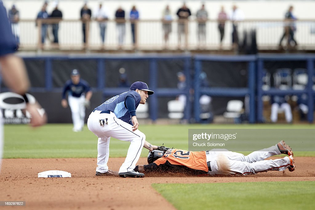 Tampa Bay Rays Shawn O'Malley (68) in action, tag vs Baltimore Orioles Alexi Casilla (12) during spring training at Charlotte Sports Park. Chuck Solomon F78 )