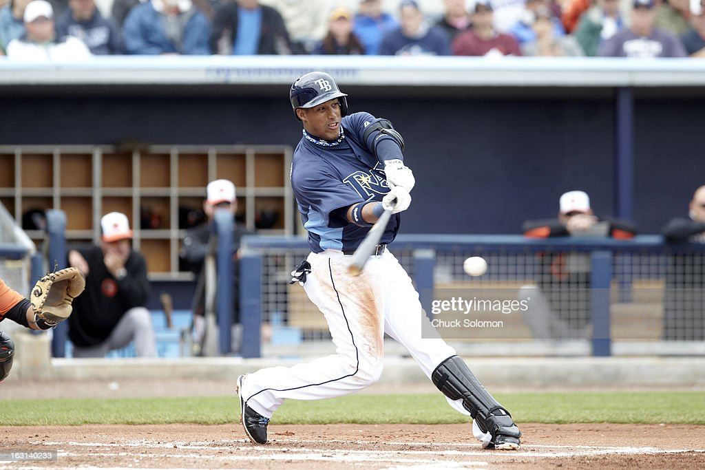 Tampa Bay Rays Yunel Escobar (11) in action, at bat vs Baltimore Orioles during spring training game at Charlotte Sports Park. Chuck Solomon F49 )