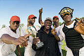 Baseball Team and Coach Celebrating Victory