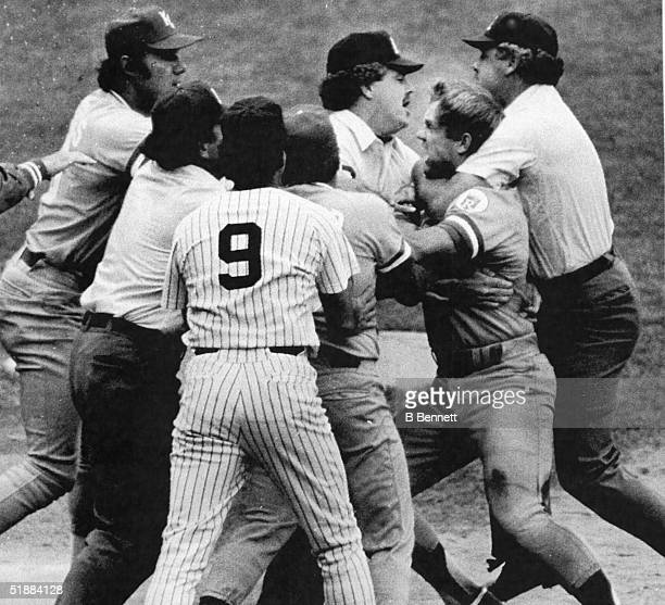 Baseball umpire Joe Brinkman collars American baseball player George Brett of the Kansas City Royals in an effort to break up a fight started when...