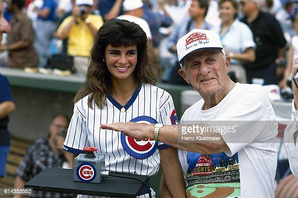 View of 91 yearold Chicago Cubs fan Harry Grossman pressing light swich vs Philadelphia Phillies First night game in Wrigley Field history Chicago IL...