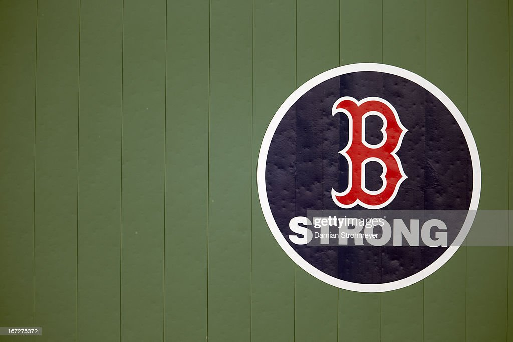View of BOSTON STRONG logo on Green Monster during Boston Red Sox vs Kansas City Royals game at Fenway Park. A ceremony was held before the game in remembrance of the victims of the 4/15/13 Boston Marathon Bombings. Damian Strohmeyer F222 )
