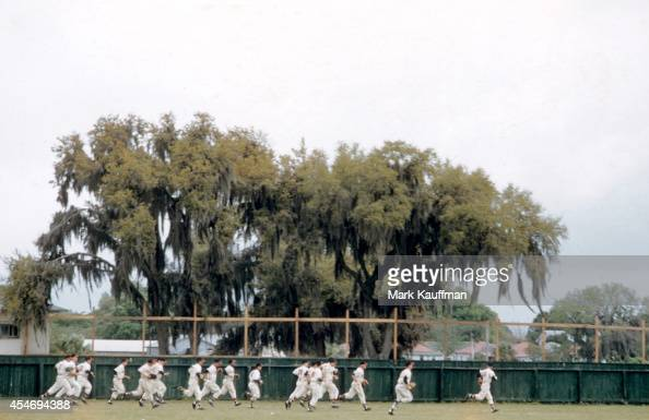 View of Milwaukee Braves players running drills in outfield during spring training workout Bradenton FL CREDIT Mark Kauffman