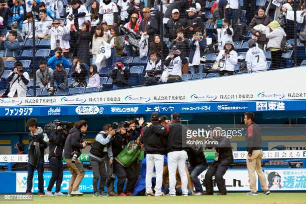 View of NipponHam Fighters Shohei Ohtani speaking with members of the media on field before game vs Chiba Lotte Marines at Chiba Marine Stadium Otani...
