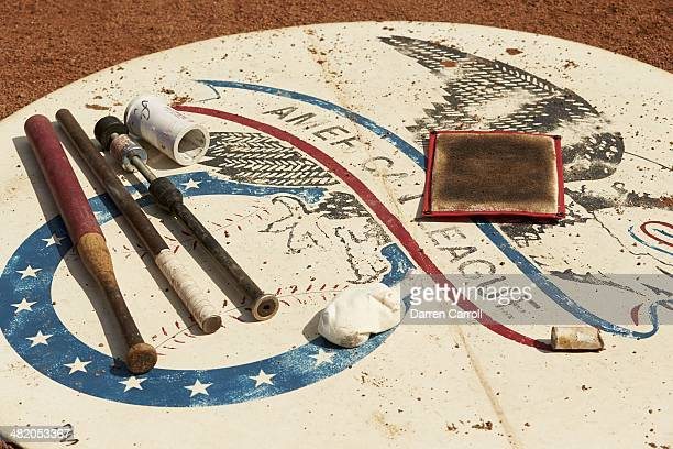 View of on deck circle with American League logo and weighted bats and pine tar rag during Texas Rangers vs Philadelphia Phillies game at Globe Life...