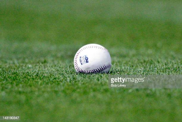 A baseball with the Astros 50th Anniversary logo sits in the grass during the game between the Los Angeles Dodgers and the Houston Astros on April 20...