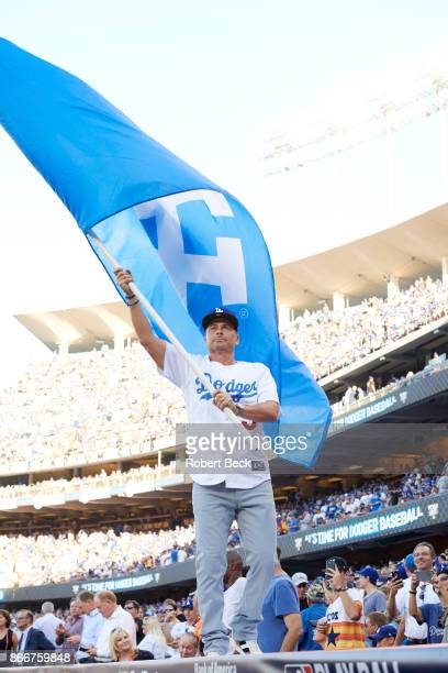 World Series Actor Rob Lowe waving Dodgers flag on top of dugout before Los Angeles Dodgers vs Houston Astros game at Dodger Stadium Game 1 Los...