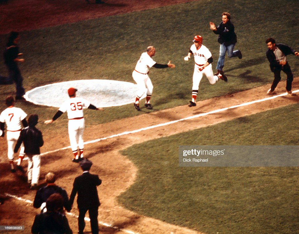 World Series Aerial view of Boston Red Sox Carlton Fisk victorious with team after hitting game winning walk off home run vs Cincinnati Reds during...